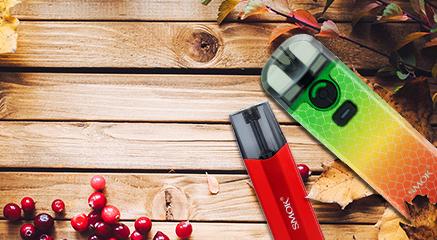 Two SMOK vape pods in autumn theme background